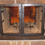 Fireplace glass doors and screen doors.
