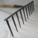 Iron Garden Rake. Approximately 20 inches wide.  Cost: $125.00  One currently in stock.  To place an order, contact Jymm via email.