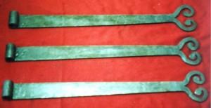 Custom strap hinges.